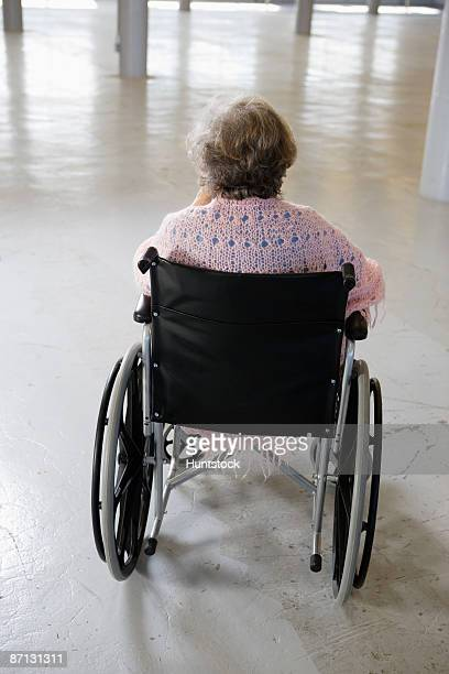 rear view of an old woman sitting in the wheelchair - one senior woman only stock pictures, royalty-free photos & images