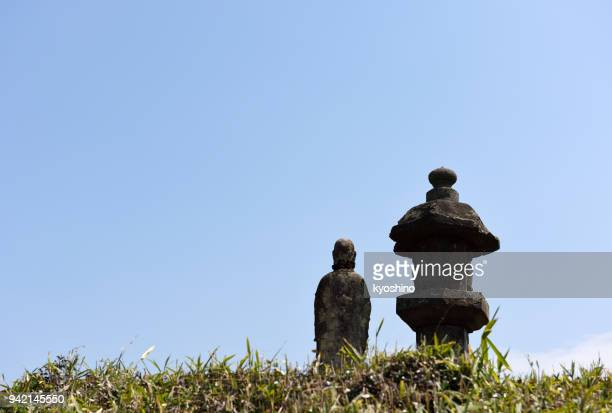 rear view of ancient jizo bodhisattva - bodhisattva stock pictures, royalty-free photos & images