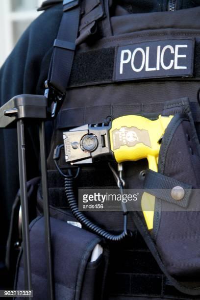 Rear view of armed policeman in London UK