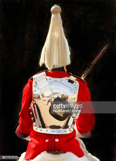 rear view of army soldier against black background - guardsman stock pictures, royalty-free photos & images