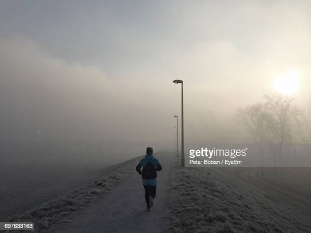 rear view of athlete running in the morning - boban stock pictures, royalty-free photos & images