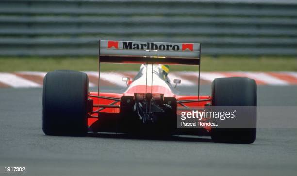 Rear view of Ayrton Senna of Brazil in action in his McLaren Honda during the Belgian Grand Prix at the Spa circuit in Belgium Senna finished in...
