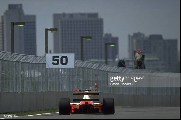 Rear view of Ayrton Senna of Brazil in action in his McLaren Honda during the Canadian Grand Prix at the Montreal circuit in Canada Senna finished in...