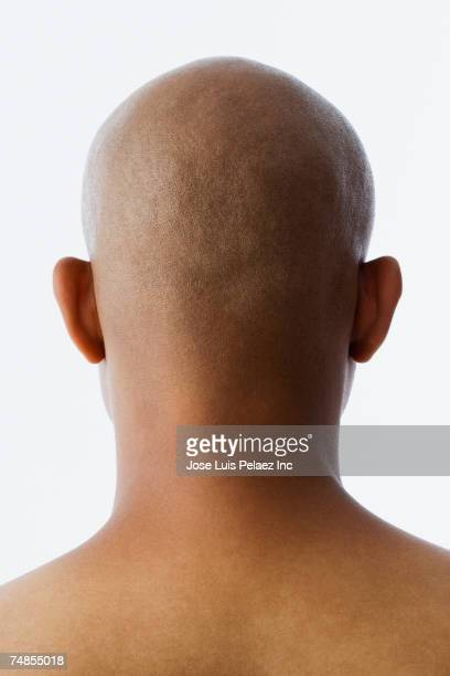 rear view of bald hispanic man - completamente calvo foto e immagini stock