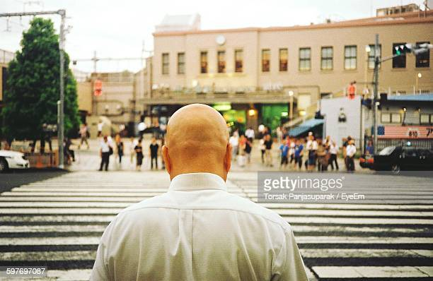 rear view of bald man zebra crossing on road in city - endast vuxna bildbanksfoton och bilder