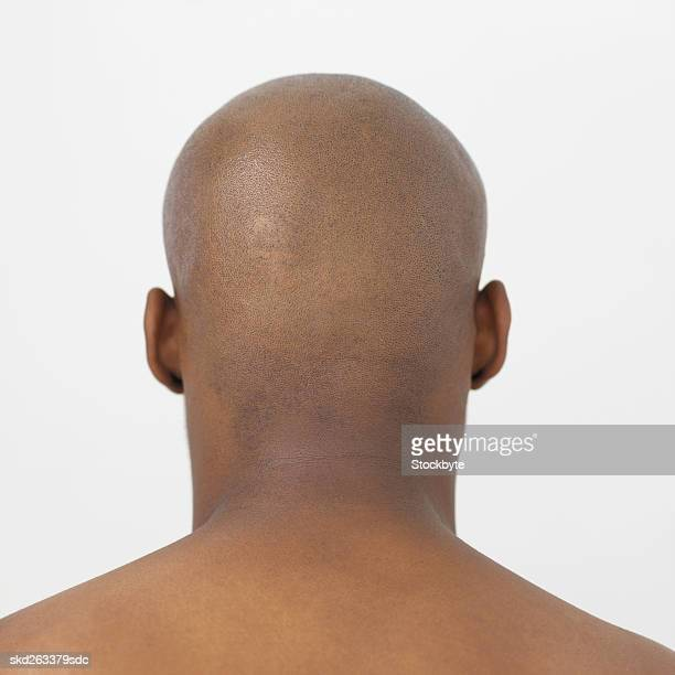 rear view of bare-chested young man - barechested bare chested ストックフォトと画像