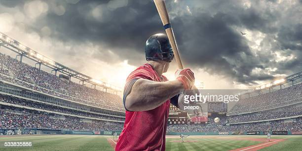 rear view of baseball batter about to hit during game - pitcher stockfoto's en -beelden