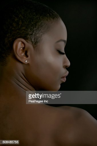 Black Label Price >> Rear View Of Black Woman With Eyes Closed Stock Photo | Getty Images