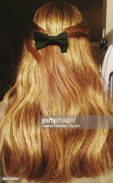 rear view of blond haired woman at home - hair bow stock pictures, royalty-free photos & images