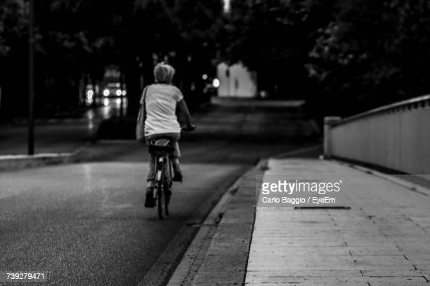 Rear View Of Boy Riding Bicycle