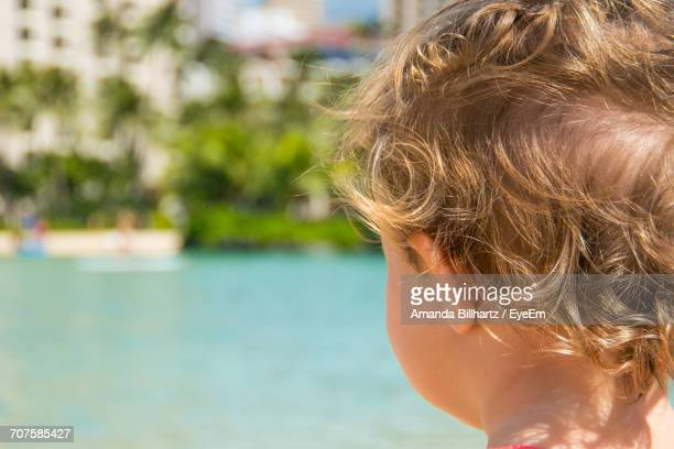 Rear View Of Boy Standing Against Sea