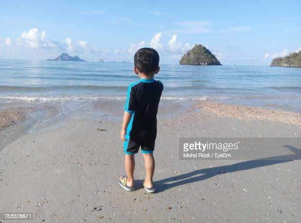 Rear View Of Boy Standing At Krabi Beach