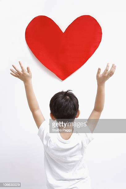 Rear view of boy standing with a valentine heart