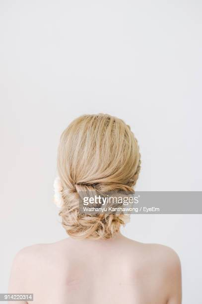 rear view of bride against white background - up do stock pictures, royalty-free photos & images