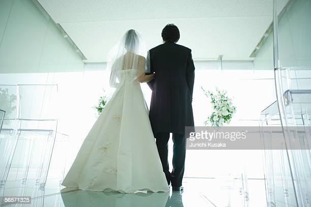 Rear view of bride and groom at altar