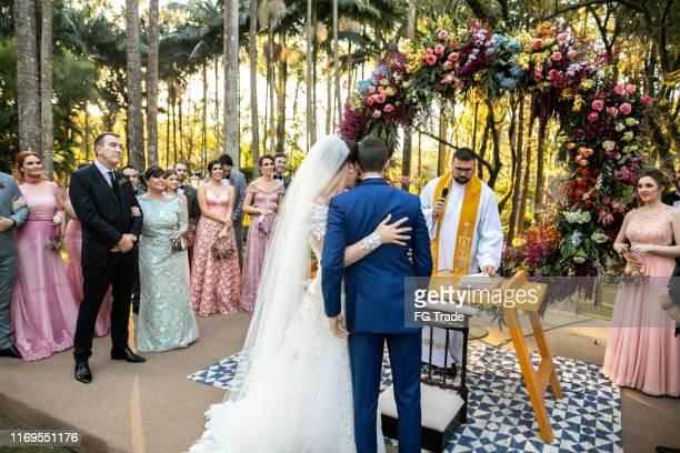 rear view of bride and groom in the altar - cattolicesimo foto e immagini stock