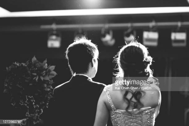 rear view of bride and groom standing - marriage stock pictures, royalty-free photos & images