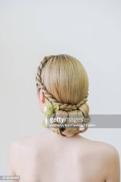 rear view of bride with blond hair against white background - up do stock pictures, royalty-free photos & images