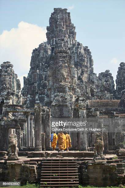rear view of buddhist monks at angkor wat, siem reap, cambodia - angkor stock photos and pictures
