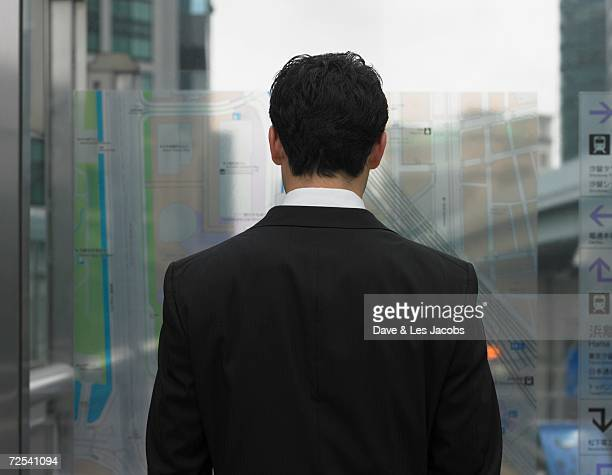Rear view of businessman looking out window