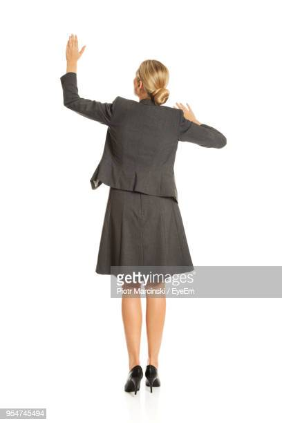 Rear View Of Businesswoman Gesturing Against White Background