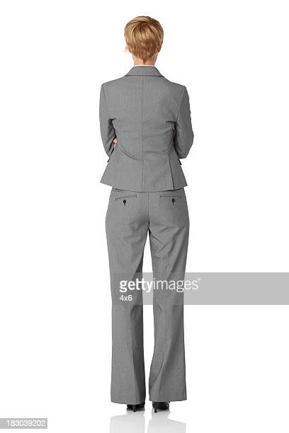 Rear view of businesswoman standing with arms crossed