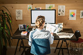 Rear View Of Businesswoman Working In Creative Office