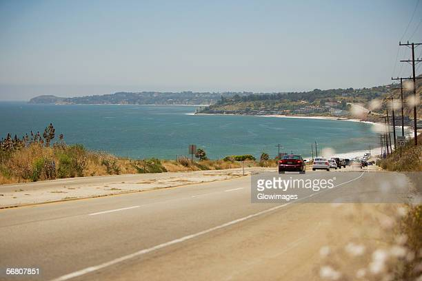 Rear view of cars on a highway, Malibu, California, USA