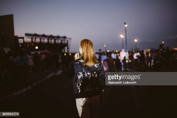 Rear view of Caucasian woman at night