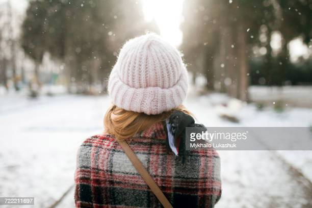 Rear view of Caucasian woman outdoors in snow