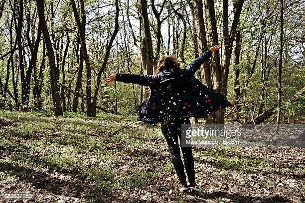 Rear View Of Cheerful Woman On Woodland