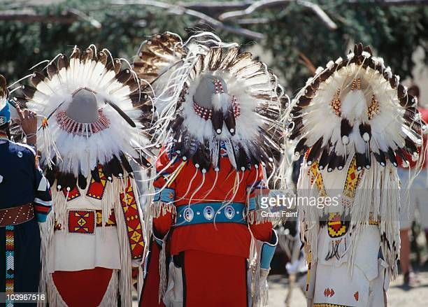 rear view of chief's headresses. - headdress stock pictures, royalty-free photos & images