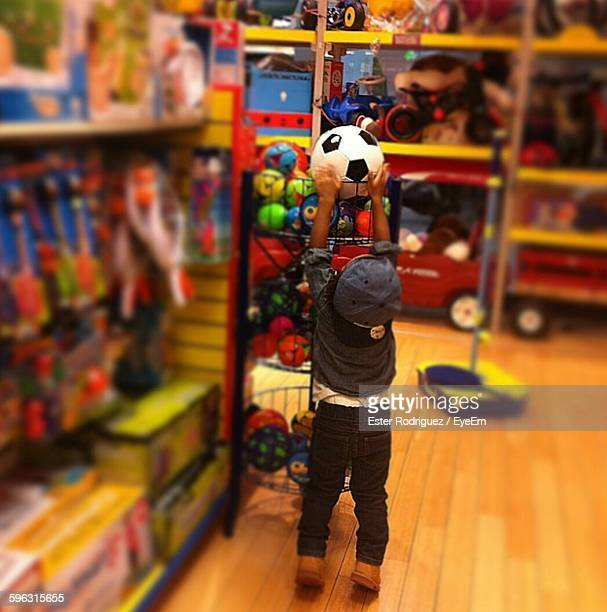 Rear View Of Child In Toy Store