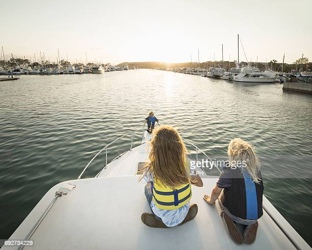 Rear view of children on bow of boat, Dana Point, California, USA