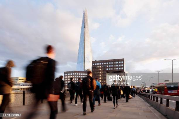rear view of city workers against london southwark skyline - central london stock pictures, royalty-free photos & images
