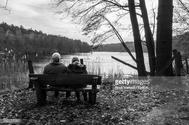 Rear View Of Couple Against Lake
