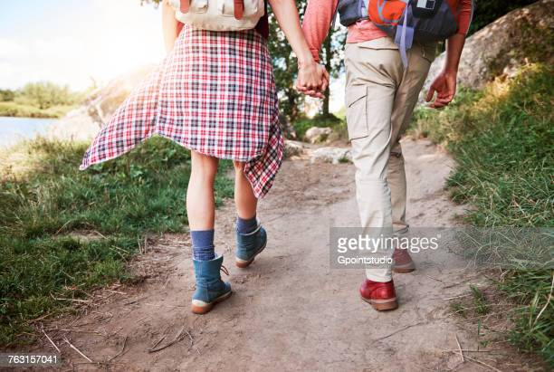 rear view of couple hiking, low section, krakow, malopolskie, poland, europe - plaid shirt stock pictures, royalty-free photos & images
