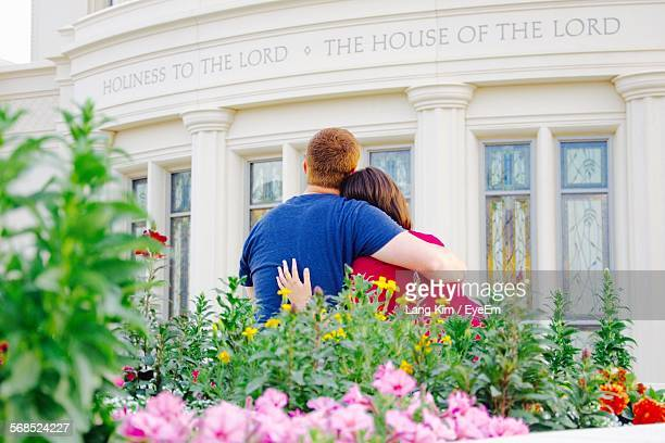 Rear View Of Couple Looking At Church