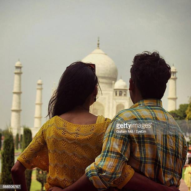 Rear View Of Couple Standing Against Taj Mahal