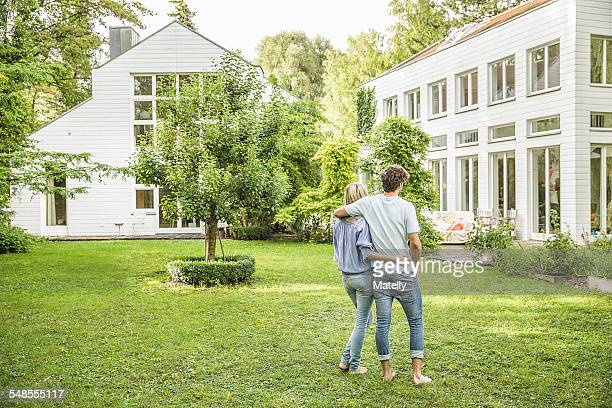 Rear view of couple strolling in garden