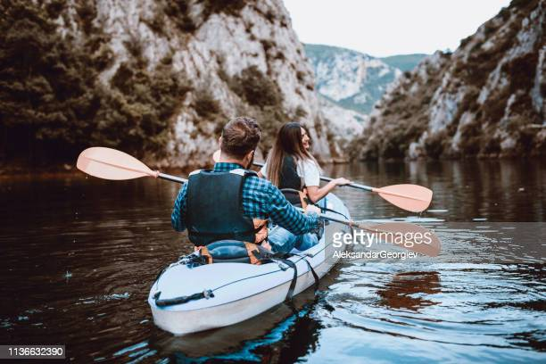 Rear View Of Cute Couple On A Kayaking Trip