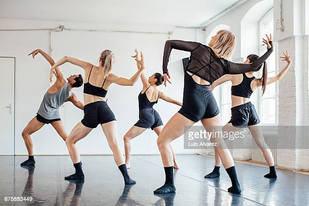 rear view of dancers dancing in studio - dance studio stock pictures, royalty-free photos & images