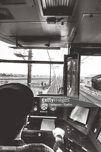 Rear View Of Driver In Train