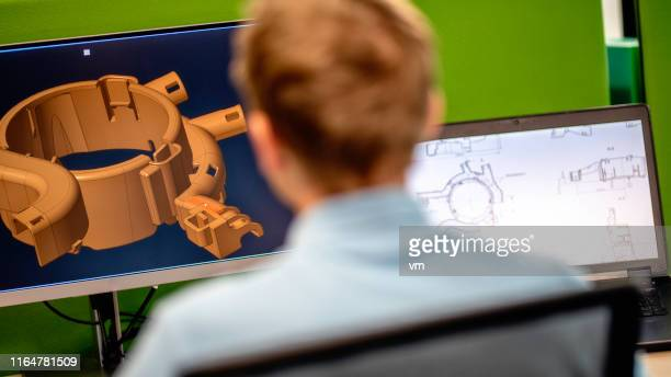 rear view of engineer using a computer - mechanical engineering stock pictures, royalty-free photos & images