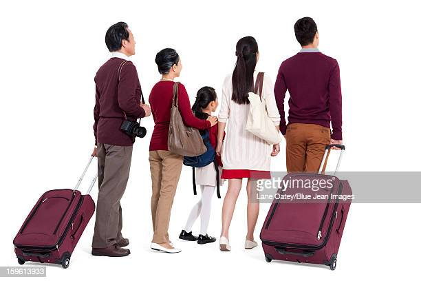 Rear view of family in a trip