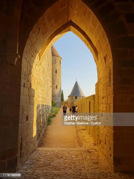 rear view of family walking at fort - guy carcassonne photos et images de collection