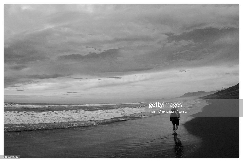 Rear View Of Father With Baby Walking On Beach : Stock Photo