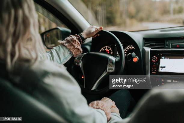 rear view of female driver - västra götaland county stock pictures, royalty-free photos & images