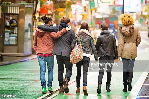 Rear view of five friends walking away in Manhattan