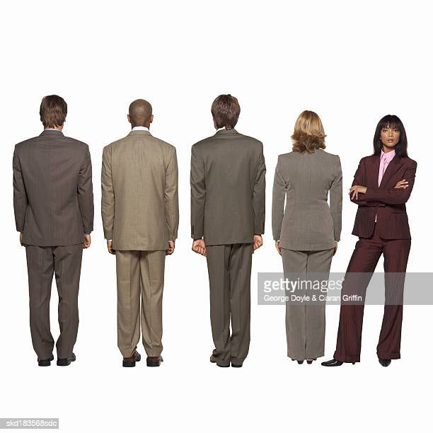 rear view of four business executives and front view portrait of a businesswoman - gray suit stock pictures, royalty-free photos & images